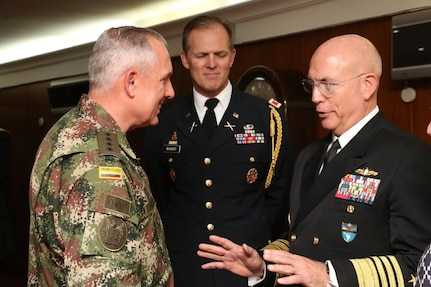 Military officers speak to one another.