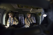Joint Terminal Attack Controllers ride in a UH-0 Black Hawk during a joint training at Warsaw, Mo., Jan. 31, 2018. The training, titled Truman Relief, gave Whiteman Air Force Base, Mo., units the opportunity to go through scenarios involving JTACs capabilities. (U.S. Air Force by Staff Sgt. Danielle Quilla)