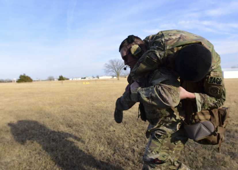 A Joint Terminal Attack Controller assigned to the 7th Air Support Operations Squadron, located in Fort Bliss, Texas, carries a team member during a joint training mission at Warsaw, Mo., Jan. 31, 2018. This training allowed units from Whiteman Air Force Base, Mo., work together with members from the 7th ASOS to standardize how JTACs are integrated into a multi-domain fight. (U.S. Air Force by Staff Sgt. Danielle Quilla)