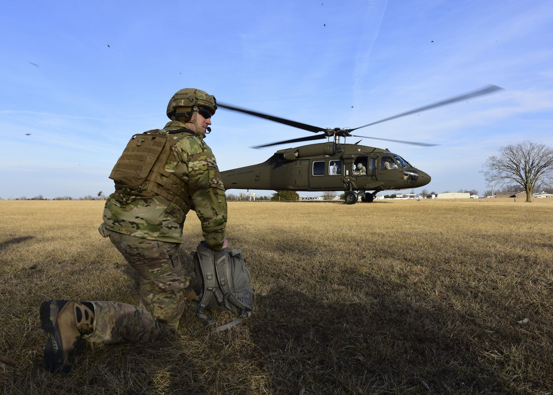 A Joint Terminal Attack Controller assigned to the 7th Air Support Operations Squadron, located in Fort Bliss, Texas,  waits for a UH-0 Black Hawk land during a joint training at Warshaw, Mo., Jan. 31, 2018. JTACs are personnel who are authorized to call airstrikes and help coordinate close-air-support missions. (U.S. Air Force by Staff Sgt. Danielle Quilla)