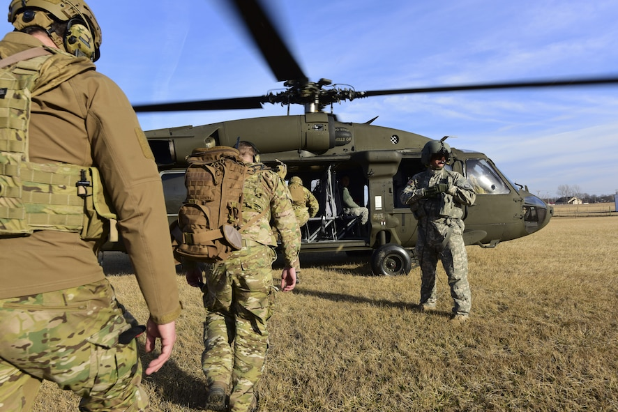 Joint Terminal Attack Controllers assigned to the 7th Air Support Operations Squadron from Fort Bliss,Texas, enter a UH-0 Black Hawk during a joint training mission at Warsaw, Mo., Jan. 31, 2018. The joint training, titled Truman Relief, involved the 509th Bomb Wing and 1-135th Assault Helicopter Battalion from Whiteman Air Force Base, Mo. (U.S. Air Force by Staff Sgt. Danielle Quilla)