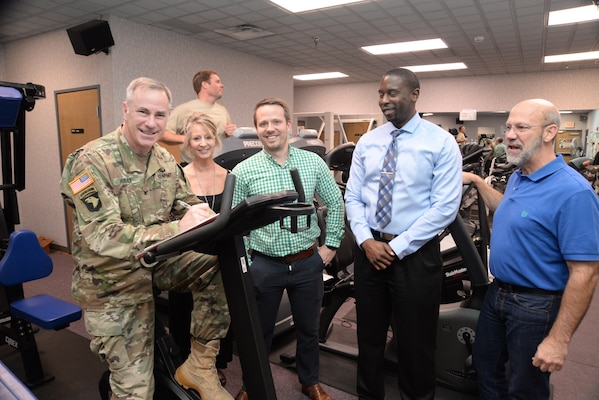Col. John Hurley, commander of the U.S. Army Engineering and Support Center, Huntsville, signs up for the 2018 Commander's Fitness Challenge at the organization's Wellness Center. Next to Hurley are members of the Huntsville Center Wellness Committee.