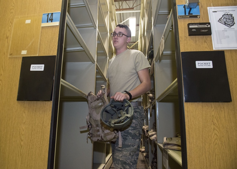 Airman 1st Class Dylan Spencer, an individual protective equipment journeyman assigned to the 97th Logistics Readiness Squadron, collects supplies for a customer Feb. 09, 2018, at Altus Air Force Base, Okla.