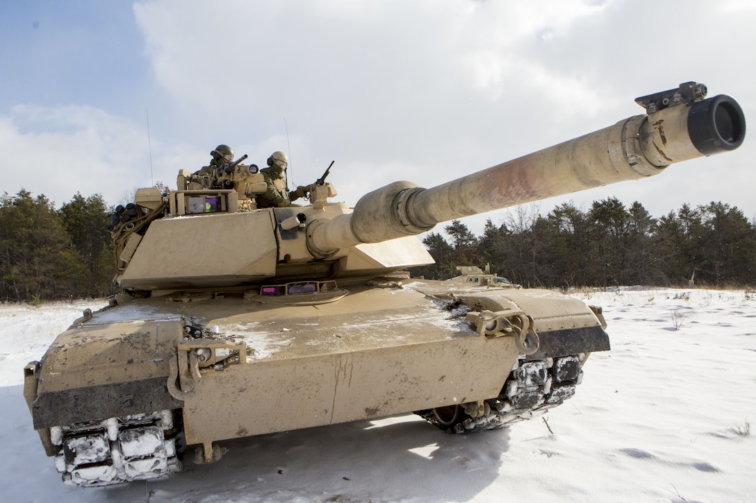 Marines with Company F, 4th Tank Battalion, 4th Marine Division, pause to check the scheme of maneuver before a platoon formation rehearsal during exercise Winter Break 2018 near Camp Grayling, Michigan, Feb. 8, 2018. Winter Break 18 challenges Marines of Fox Co., 4th Tank Bn. to contend with employment problems caused by extreme cold weather and snow and adapt to the operational challenges of a severe climate.