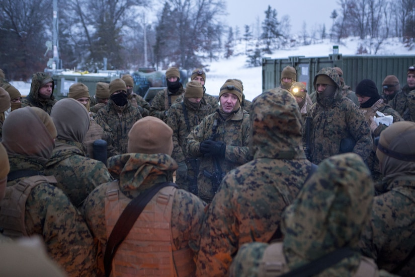 Capt. Andrew Bender, commanding officer of Company F, 4th Tank Battalion, 4th Marine Division, talks to his Marines about the importance of communication during cold weather training at exercise Winter Break 2018, near Camp Grayling, Michigan, Feb. 8, 2018. The safety brief kicked of day two the training exercise during which Fox Co. Marines rehearsed formations, conducted advanced land navigation and terrain identification and performed preventative maintenance checks and services on their armored vehicles and equipment while increasing their operational capacity in single degree temperatures and snow covered terrain.