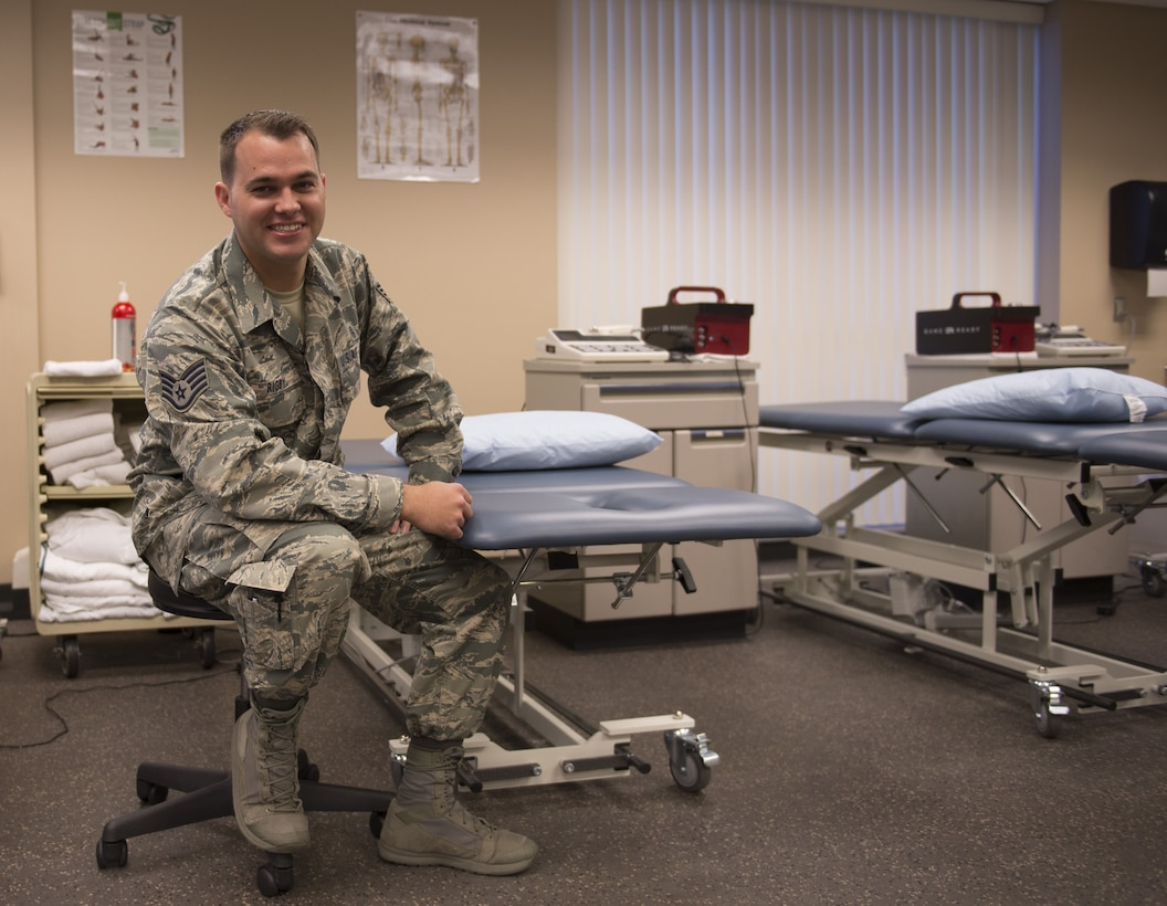 Staff Sgt. Geoffrey Rigby, 56th Medical Operations Squadron physical therapy technician, poses in the physical therapy clinic at Luke Air Force Base, Feb. 6, 2018. Rigby used his lifelong medical knowledge and training to apply life-saving techniques to a car accident victim on Jan. 16 in Glendale, Ariz. (U.S. Air Force photo/Senior Airman Ridge Shan)