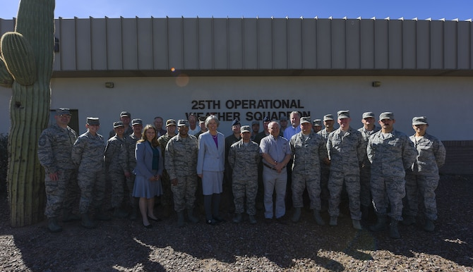 Officials from the U.S. Southern Command pose for a group photo at Davis-Monthan Air Force Base, Ariz., Feb. 6, 2018. Meteorology and oceanography specialists from various sections of the Department of Defense gathered for a 2-day-long USSOUTHCOM-sponsored conference that allowed them to discuss lessons learned from 2017 and ways to better communicate with one another in the future. (U.S. Air Force photo by Airman 1st Class Frankie D. Moore)