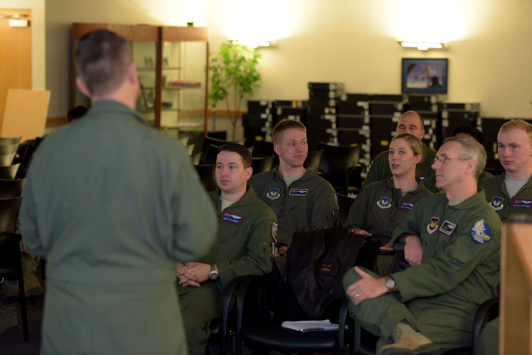 Airmen ask questions during a career enlisted aviator roadshow briefing at RAF Mildenhall, England, Feb. 8, 2018.  The question and answer session was one of three briefings during the senior enlisted leaders' visit to discuss issues and programs pertaining to the CEA career fields. (U.S. Air Force photo by Senior Airman Alexandra West)