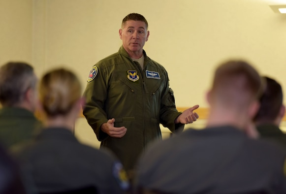 U.S. Air Force Chief Master Sgt. Randy Scanlan, Air Force Personnel Center chief of enlisted aircrew assignments, Joint Base San Antonio-Randolph, conducts a question and answer session with boom operators at RAF Mildenhall, Feb. 8, 2018. The question and answer session was one of three briefings during the senior enlisted leaders' visit to discuss issues and programs pertaining to the CEA career fields. (U.S. Air Force photo by Senior Airman Alexandra West)