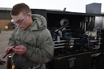 Airman 1st Class Nathan Gette, 48th Equipment Maintenance Squadron aerospace ground equipment technician, works to redo electrical wires for a hydraulic test stand at Royal Air Force Lakenheath, England, Feb. 7. AGE Airmen fix, maintain and perform routine maintenance on flightline equipment. (U.S. Air Force photo/Senior Airman Abby L. Finkel)