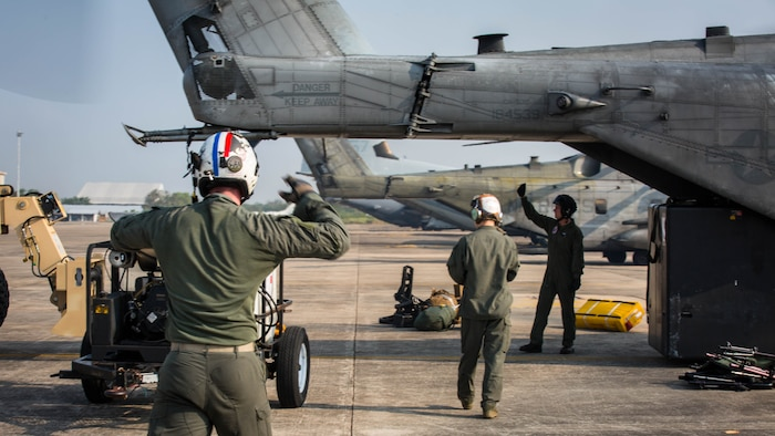 U.S. Marines with Marine Heavy Helicopter Squadron 466 'Wolfpack' unload a CH-53E Super Stallion on the runway at U-Tapao International Airport, Kingdom of Thailand, Feb. 10, 2018. HMH-466 'Wolfpack' arrive to the Kingdom of Thailand to participate in the 37th iteration of Cobra Gold as part of the U.S. Marine Corps Aviation Combat Element. The Super Stallion is assigned to HMH-466, Marine Aircraft Group 16, 3rd Marine Aircraft Wing, currently forward deployed under the unit deployment program with MAG-36, 1st MAW, based out of Okinawa, Japan. Exercise Cobra Gold 2018 is an annual exercise conducted in the Kingdom of Thailand held from Feb. 13-23 with seven full participating nations.