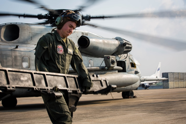 A U.S. Marine with Marine Heavy Helicopter Squadron 466 'Wolfpack' unloads equipment from a CH-53E Super Stallion on the runway at U-Tapao International Airport, Kingdom of Thailand, Feb. 10, 2018. HMH-466 'Wolfpack' arrive to the Kingdom of Thailand to participate in the 37th iteration of Cobra Gold as part of the U.S. Marine Corps Aviation Combat Element. The Super Stallion is assigned to HMH-466, Marine Aircraft Group 16, 3rd Marine Aircraft Wing, currently forward deployed under the unit deployment program with MAG-36, 1st MAW, based out of Okinawa, Japan. Exercise Cobra Gold 2018 is an annual exercise conducted in the Kingdom of Thailand held from Feb. 13-23 with seven full participating nations.