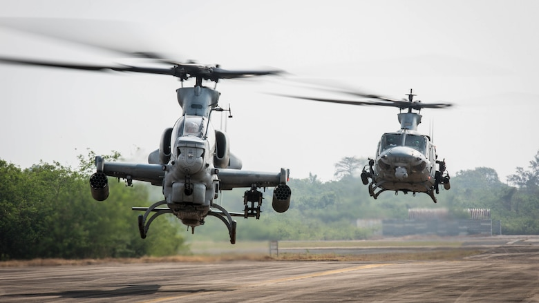 An AH-1Z Viper and a UH-1Y Venom taxis off the runway at U-Tapao International Airport, Kingdom of Thailand, Feb. 10, 2018. Marine Light Attack Helicopter Squadron 369 'Gunfighters' arrive to the Kingdom of Thailand to participate in the 37th iteration of Cobra Gold as part of the U.S. Marine Corps Aviation Combat Element. HMLA-369, Marine Aircraft Group 39, 3rd Marine Aircraft Wing, is currently forward deployed under the unit deployment program with MAG-36, 1st MAW. Exercise Cobra Gold 2018 is an annual exercise conducted in the Kingdom of Thailand held from Feb. 13-23 with seven full participating nations.