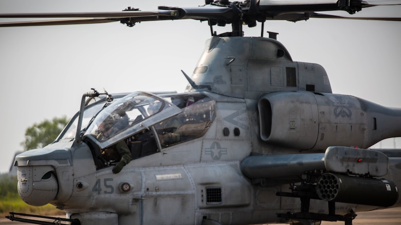 U.S. Marine pilots prepare to disembark an AH-1Z Viper at U-Tapao International Airport, Kingdom of Thailand, Feb. 10, 2018. The Marines of Marine Light Attack Helicopter Squadron 369 'Gunfighters' arrive to the Kingdom of Thailand to participate in Cobra Gold, one of the largest theater security cooperation exercises in the Indo-Asia-Pacific region. HMLA-369, Marine Aircraft Group 39, 3rd Marine Aircraft Wing, is currently forward deployed under the unit deployment program with MAG-36, 1st MAW. Exercise Cobra Gold 2018 is an annual exercise conducted in the Kingdom of Thailand held from Feb. 13-23 with seven full participating nations.