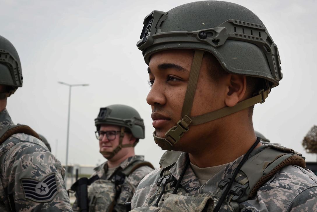 U.S. Air Force Airman 1st Class Austin Bryant, 39th Security Forces Squadron member, listens as Lt. Gen. Richard M. Clark, 3rd Air Force commander, speaks to Airmen at Incirlik Air Base, Turkey, Feb. 9, 2018.