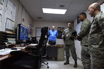 U.S. Air Force Lt. Gen. Richard M. Clark, 3rd Air Force commander, and Chief Master Sgt. Anthony Cruz-Munoz, 3rd Air Force command chief, receive a briefing from 39th Medical Group personnel at Incirlik Air Base, Turkey, Feb. 9, 2018.