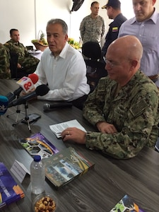 U.S. Navy Adm. Kurt W. Tidd conducts a press briefing with Colombian Vice President Oscar Naranjo