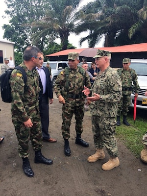 U.S. Navy Adm. Kurt W. Tidd talks with members of the Colombian military