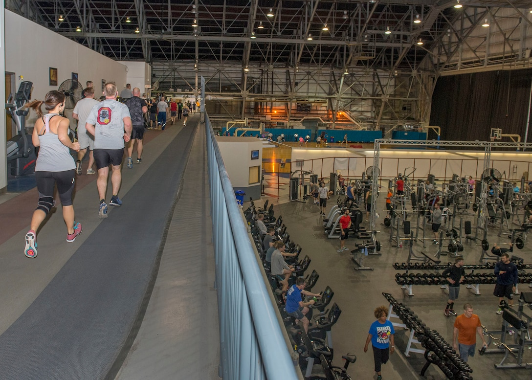 Members of Wright-Patterson Air Force Base exercise inside Wright Field Fitness Center at Wright-Patterson Air Force Base, Ohio, Jan. 25, 2017. The Fitness Center operated by the 88th Force Support Squadron offers an indoor running track, aerobics, indoor cycling, yoga, equipment instruction, kickboxing, and special services such as massage therapy and personal fitness trainers. (U.S. Air Force photo by Michelle Gigante/Released)