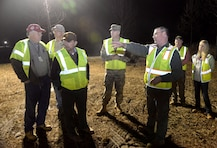 """John Lewis, third from right, describes a training site layout to Col. John Hurley, commander of the U.S. Army Engineering and Support Center, Huntsville, and Huntsville Center Program Director Albert """"Chip"""" Marin, during the leaders' Jan. 11 visit to Redstone Arsenal. Accompanying them, from left to right, are Bill Sargent, director of Huntsville Center's Ordnance and Explosives Directorate; Roger Young, project manager with APTIM; Jason Watson, Redstone environmental site manager; and Ashley Roeske, project manager with Huntsville Center's Chemical/Biological Warfare Materiel Division."""
