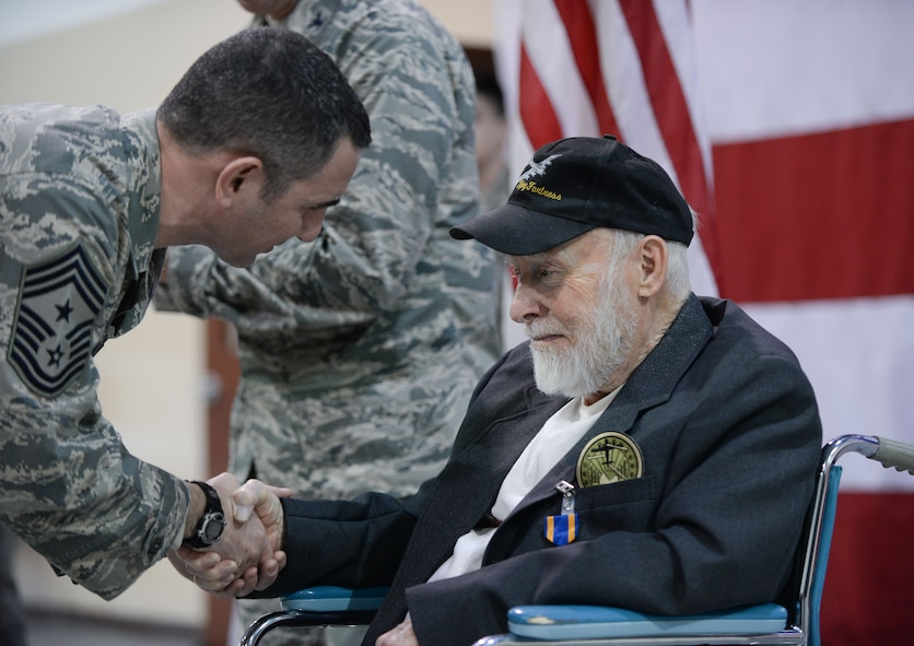 Chief Master Sgt. Brian Kruzelnick, 55th Wing command chief, thanks Gail Farrell, a 93-year old World War II and Korean War veteran who flew 21 missions as a tail gunner in the B-17 Flying Fortress, for his service after a medal presentation ceremony at the James M. McCoy Airman Leadership School Feb. 8, 2018. Col. Mike Manion, 55th Wing commander, presented Farrell with an Air Medal with two oak leaf clusters; the European-African Middle Eastern Campaign Medal with three bronze service stars; the American Campaign Medal; the World War II Victory Medal; and the Honorable Service Lapel Button, WWII.