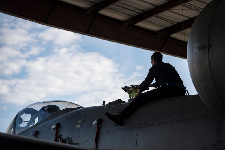 Senior Airman Michael Atkinson, 74th Aircraft Maintenance Unit dedicated crew chief, protects a component before washing an A-10C Thunderbolt II, Feb. 8, 2018, at Moody Air Force Base, Ga. Airmen sealed off various electrical components prior to the wash to protect them from chemicals within the soap. In addition to mechanical and electrical maintenance, A-10's must be washed every 180 days or approximately 1,000 flying hours in order to control corrosion caused by residue from the gun and engine exhaust. (U.S. Air Force photo by Senior Airman Janiqua P. Robinson)