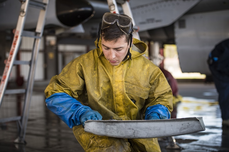 Senior Airman Michael Atkinson, 74th Aircraft Maintenance Unit dedicated crew chief, cleans a component of an A-10C Thunderbolt II, Feb. 8, 2018, at Moody Air Force Base, Ga. In addition to mechanical and electrical maintenance, A-10's must be washed every 180 days or approximately 1,000 flying hours in order to control corrosion caused by residue from the gun and engine exhaust. (U.S. Air Force photo by Senior Airman Janiqua P. Robinson)
