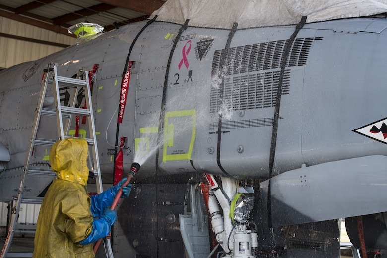 Senior Airman Michael Atkinson, 74th Aircraft Maintenance Unit dedicated crew chief, sprays the side of an A-10C Thunderbolt II, Feb. 8, 2018, at Moody Air Force Base, Ga. In addition to mechanical and electrical maintenance, A-10's must be washed every 180 days or approximately 1,000 flying hours in order to control corrosion caused by residue from the gun and engine exhaust. (U.S. Air Force photo by Senior Airman Janiqua P. Robinson)