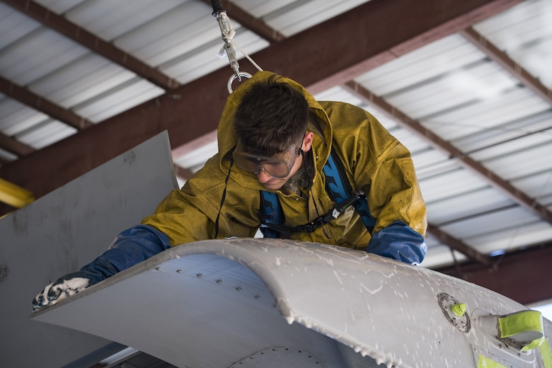 Airman 1st Class Jake Dromgold, 74th Aircraft Maintenance Unit crew chief, washes the wing of an A-10C Thunderbolt II, Feb. 8, 2018, at Moody Air Force Base, Ga. In addition to mechanical and electrical maintenance, A-10's must be washed every 180 days or approximately 1,000 flying hours in order to control corrosion caused by residue from the gun and engine exhaust. (U.S. Air Force photo by Senior Airman Janiqua P. Robinson)