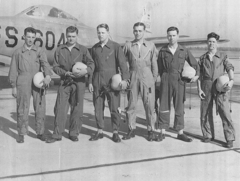 U.S. Air Force pilots assigned to the 79th Fighter Squadron (FS) stand for a photo in front of an F-84B Thunderjet at Shaw Air Force Base, S.C., circa May 1949.