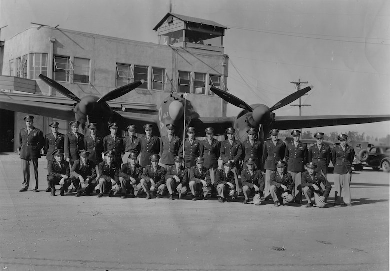 U.S. Army Air Corps pilots assigned to the 79th Fighter Squadron pose in front of a P-38 Lightning at Ontario, Calif., in 1943.