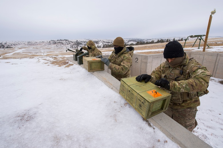 Airmen unloading ammo from boxes