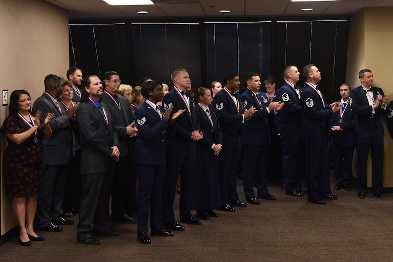 Annual Award nominees celebrate during the 25th Annual Awards Ceremony at the McNeese Convention Center in San Angelo, Texas, Feb. 9, 2018. Each nominee received a medallion as recognition for their nomination. (U.S. Air Force photo by Airman 1st Class Zachary Chapman)