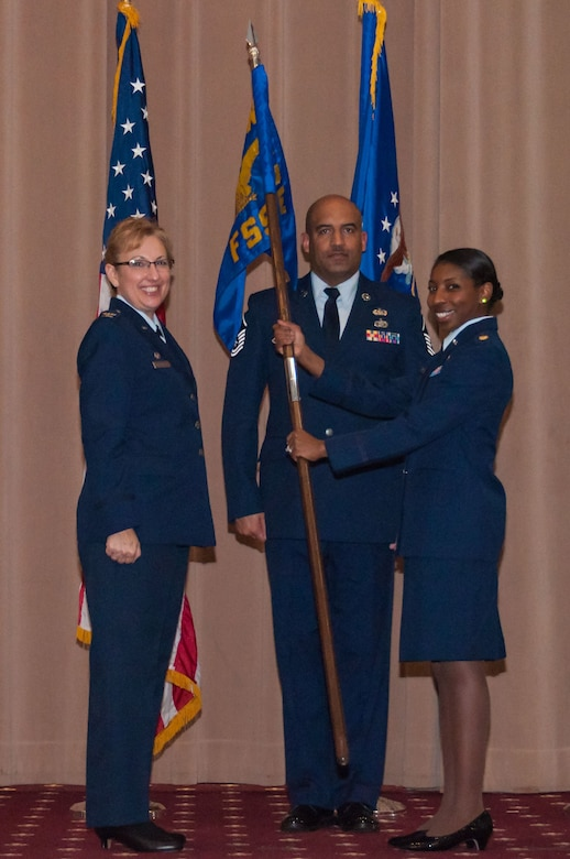 U.S Air Force Col. Sandra Vandiviere, 307th Mission Support Group commander, hands the 307th Force Support Squadron guidon to Maj. Jessica Sellers, 307th FSS, during a change of command ceremony at Barksdale Air Force Base, Louisiana, Feb. 10, 2018.