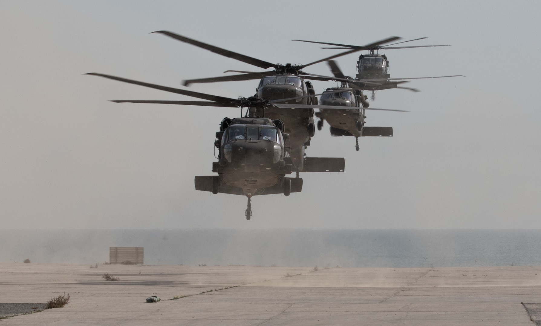 UH-60 Black Hawk helicopters carrying distinguished visitors arrive for Army Day 2018, Feb. 9, 2018, Kuwait Naval Base, Kuwait. Army Day was the opening event for U.S. Central Command's Component Commanders Conference that allowed U.S. Army Central to showcase the Army's capabilities at the theater level. (U.S. Army photo by Sgt. 1st Class Ty McNeeley, U.S. ARCENT PAO)