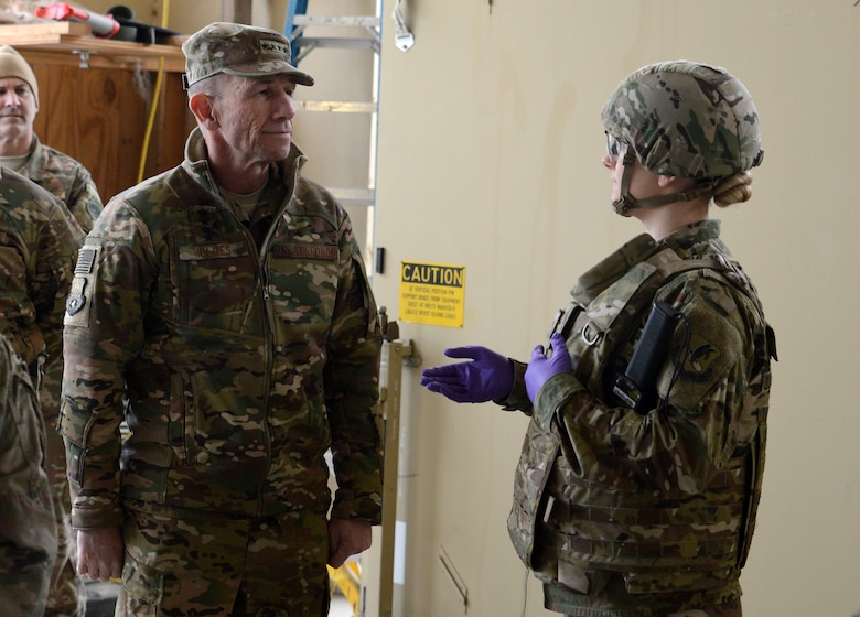 Gen. Mike Holmes, commander of Air Combat Command, receives a medical brief from Senior Airman Jessica Eyler, 455th Expeditionary Medical Group medic, Feb. 9, 2018 at Bagram Airfield, Afghanistan.
