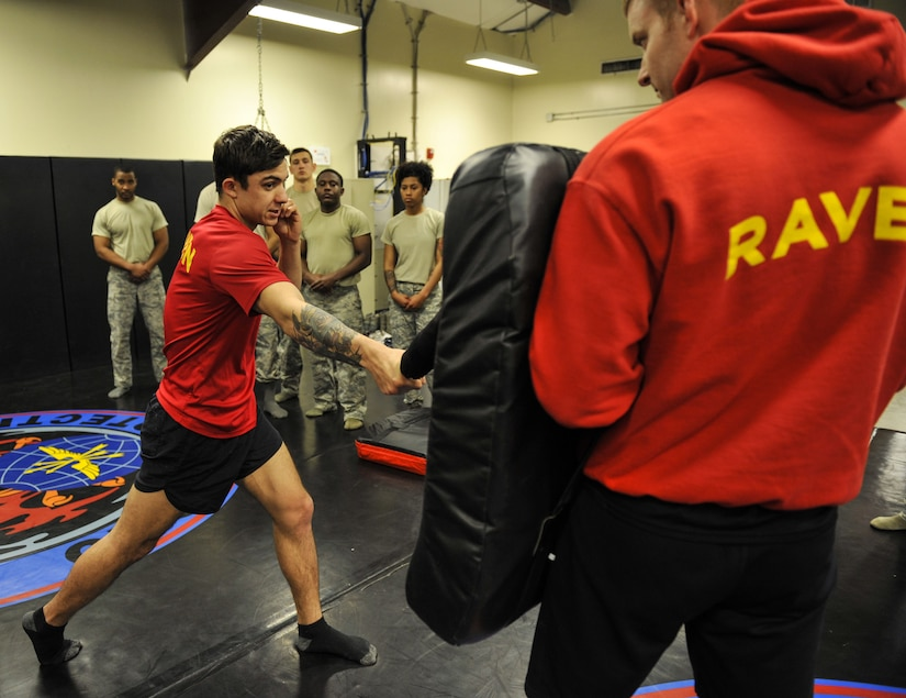 Staff Sgt. George Carty, 628th Security Forces Squadron Phoenix Raven, demonstrates proper striking techniques to Phoenix Raven candidates Jan. 31, 2018, at Joint Base Charleston, S.C.