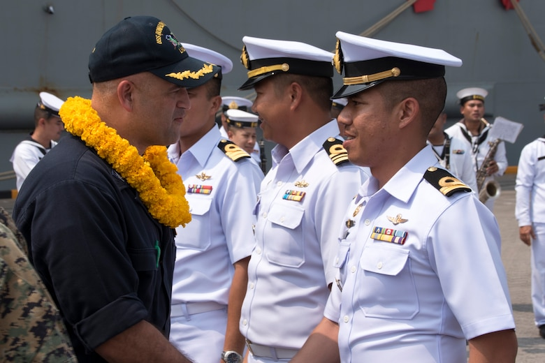 180211-N-XK809-260 LAEM CHABANG, Thailand (Feb. 11, 2018) Capt. Richard LeBron, executive officer of the amphibious assault ship USS Bonhomme Richard (LHD 6), greets Royal Thai Navy officers upon the ship's arrival to Laem Chabang.