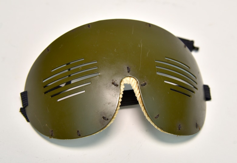 """Plans call for this artifact to be displayed near the B-17F Memphis Belle™ as part of the new strategic bombardment exhibit in the WWII Gallery, which opens to the public on May 17, 2018. Armored flak goggles issued to Memphis Belle navigator Capt Charles """"Chuck"""" Leighton."""