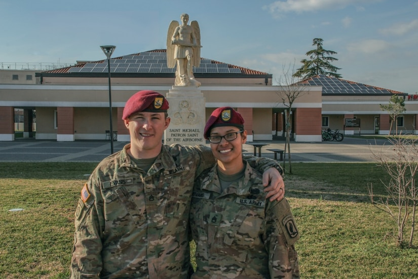Married airborne soldiers pose in front of the St. Michael statue in Vicenza, Italy.