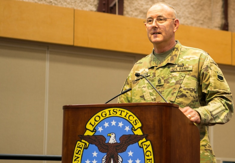 The 80th Training Command's outgoing senior leader Command Sgt. Maj. Jeffrey Darlington says goodbye at the command's change of responsibility ceremony held at the Defense Supply Center Richmond, Virginia, during the 80th TC Commander's Readiness Workshop Feb. 8, 2018.  At the ceremony, Darlington handed over the reins to the incoming senior leader Command Sgt. Maj. Dennis Thomas. (U.S. Army Reserve Photo by Maj. Addie Leonhardt)