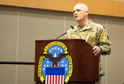 Maj. Gen. Bruce Hackett, commanding general of the 80th Training Command, speaks at the command's change of responsibility ceremony held at the Defense Supply Center Richmond, Virginia, during the 80th TC Commander's Readiness Workshop Feb. 8, 2018.  At the ceremony, the outgoing senior leader Command Sgt. Maj. Jeffrey Darlington handed over the reins to the incoming senior leader Command Sgt. Maj. Dennis Thomas. (U.S. Army Reserve Photo by Maj. Addie Leonhardt)