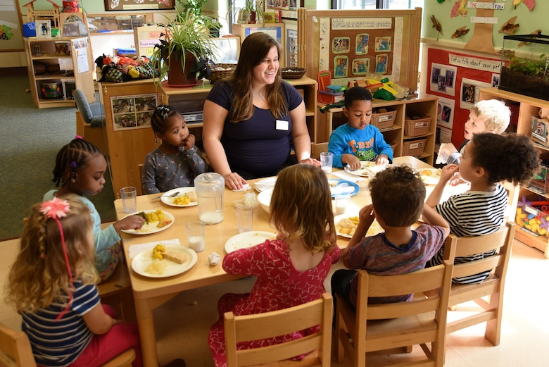 Meredith Yoder, 20th Force Support Squadron (FSS) program assistant, center, converses with children in her class during lunch at the 20th FSS Child Development Center at Shaw Air Force Base, S.C., Feb. 12, 2018.