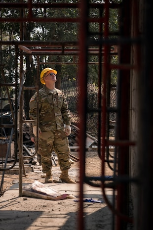 U.S. Army Spc. Todd Fedele surveys a construction site of a school building in support of Exercise Cobra Gold 2018 at Nongphipadungkhitwittaya School in Korat, Kingdom of Thailand, Feb. 7, 2018. Fedele is an electrician with 797th Engineering Company, 411th Engineer Battalion, and is a native of Yigo, Guam. Humanitarian civic assistance projects conducted during the exercise support the needs and humanitarian interests of the Thai people. Cobra Gold 18 is an annual exercise conducted in the Kingdom of Thailand held from Feb. 13-23 with seven full participating nations.