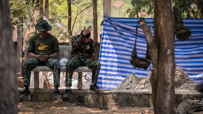 Royal Thai Army soldiers take a break during construction of a school building in support of Exercise Cobra Gold 2018 at Nongphipadungkitwittaya School in Korat, Kingdom of Thailand, Feb. 7, 2018. Humanitarian civic assistance projects conducted during the exercise support the needs and humanitarian interests of the Thai people. Cobra Gold 18 is an annual exercise conducted in the Kingdom of Thailand held from Feb. 13-23 with seven full participating nations.