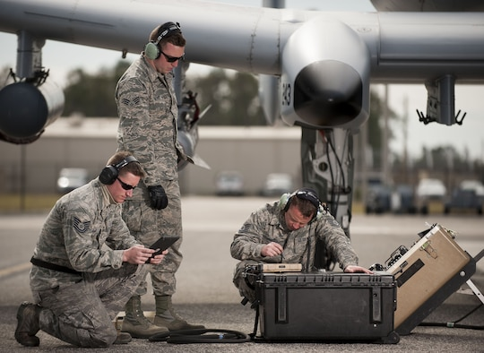 "Tech. Sgt. Jack Glad, 122nd Weapons Load, left, Senior Airman Logan Jones, 122nd Avionics, and Tech. Sgt. Mathew Habart, 122nd Avionics, from the 122nd Fighter Wing, Fort Wayne, Ind.,  upload avionics software to an A-10C Thunderbolt II ""Warthog"" during Operation Guardian Blitz, Jan 25, 2018, at MacDill Air Force Base, Fla. Guardian Blitz is a two-week joint exercise to improve service interoperability for combat search and rescue and close air support. (U.S. Air National Guard photo by Staff Sgt. William Hopper/Released)"