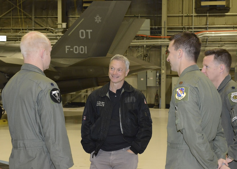 Film and TV actor Gary Sinise was given a tour of the 31st Test and Evaluation Squadron Feb. 11 before performing a free concert for the Edwards community Feb. 11. Sinise received a planeside briefing from three test pilots who talked about the F-35 Lightning II, which is a fifth-generation fighter aircraft being tested at Edwards. (U.S. Air Force photo by Kenji Thuloweit)