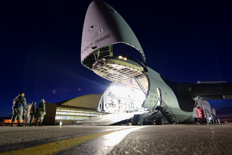 A C-5M Super Galaxy carrying equipment from the recent deployment to Andersen Air Force Base, Guam, is unloaded by 28th Logistics Readiness Squadron Airmen on the flight line at Ellsworth AFB, S.D., Feb. 2, 2018. Multiple aircraft were needed to get all of the cargo back from Andersen AFB. (U.S. Air Force photo by Senior Airman Randahl J. Jenson)