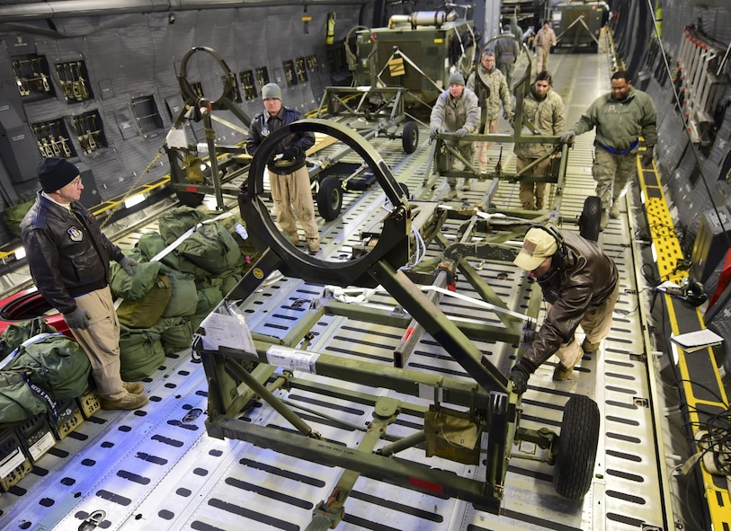 Aircrew members and Airmen from the 28th Logistics Readiness Squadron unload cargo from a C-5M Super Galaxy at Ellsworth Air Force Base, S.D., Feb. 2, 2018. Equipment used in the recent deployment to Andersen AFB, Guam, was flown back to Ellsworth AFB between Jan. 30 and Feb. 6, where it was unloaded by the 28th LRS and sent back to its respective squadrons. (U.S. Air Force photo by Senior Airman Randahl J. Jenson)