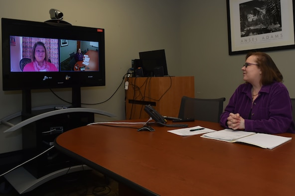 Gayle Kenyon, health promotion coordinator assigned to the 97th Medical Group, has a video tele-conference with Ann Elkins, clinical dietitian assigned to the 412th Medical Group, discussing the progress of the new tele-medical nutrition therapy program